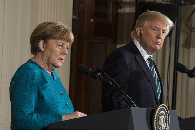 epa05854809 US President Donald J. Trump (R) and German Chancellor Angela Merkel (L) speak during a joint news conference in the East Room of the White House in Washington, DC, USA, 17 March 2017. Merkel's original visit on 14 March had to be postponed due to bad weather.  EPA/JIM LO SCALZO