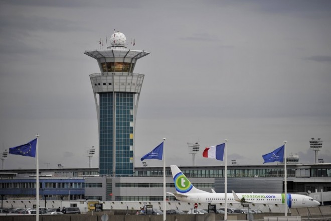 epa05855578 (FILE) - A plane rolls near the Control Tower of the Orly airport, near Paris, France, 21 July 2010 (reissued 18 March 2017).  According to news reports on 18 March 2017, a person has been shot at Orly Airport after trying to snatch a soldier's weapon.  EPA/YOAN VALAT
