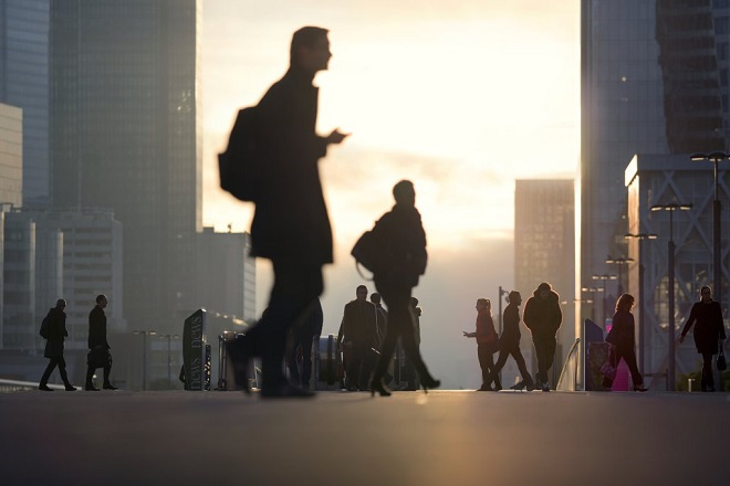 Morning image with business people and office workers arriving by subway at La Defense business district in Paris, France.