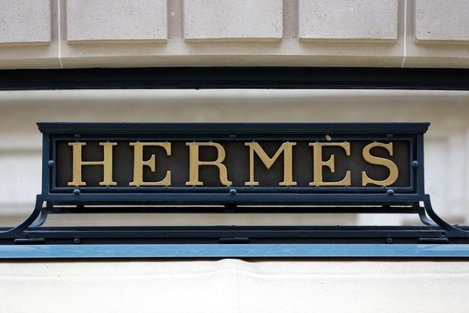 A Hermes sign is seen on one of their stores in Paris, France, March 21, 2013.   REUTERS/Philippe Wojazer/File Photo
