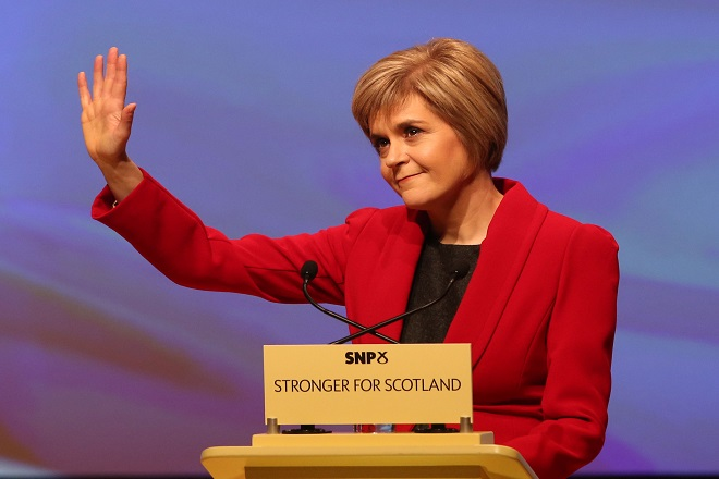 Newly appointed SNP leader Nicola Sturgeon gestures to the audience during her speech at the annual party conference at Perth Concert Hall, Scotland.