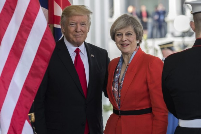 epa05755221 US President Donald J. Trump greets British Prime Minister Theresa May as she arrives at the White House in Washington, DC, USA, 27 January 2017. Prime Minister May is the first foreign head of state to meet with President Trump at the White House.
