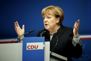 epa05770435 Cherman Chancellor Angela Merkel speaks at the regional party conference of the CDU Schleswig-Holstein in Neumuenster, Germany, 04 February 2017. Federal state elections in Schleswig-Holstein will be held on 07 May 2017.  EPA/CARSTEN KOALL