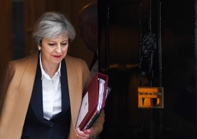 epaselect epa05876781 British Prime Minister Theresa May departs 10 Downing Street in central London, Britain, 29 March 2017 to make a statement to Parliament officially triggering Article 50 formally begining Britain's departure from the European Union. Theresa May has signed the letter giving official notice under Article 50 of the Lisbon Treaty, and which will be delivered to European Council president Donald Tusk by the British ambassador to the EU, Sir Tim Barrow later on 29 March 2017.  EPA/ANDY RAIN