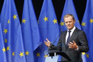 "Poland's Prime Minister Donald Tusk delivers a speech during the inauguration of the ""Esplanade Solidarnosc 1980"" and ""Agora Simone Veil"" at the EU Parliament in Brussels August 30, 2011.   REUTERS/Francois Lenoir  (BELGIUM - Tags: POLITICS) - RTR2QJTO"