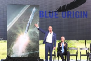 Amazon.com CEO and Blue Origin founder Jeff Bezos, left, debuts a launch vehicle on Tuesday, Sept. 15, 2015, as Florida Gov. Rick Scott applauds during a press conference at launch complex 36 at Cape Canaveral Air Force Station. Bezos said his company would bring over 300 new jobs to Florida's space coast. (Red Huber/Orlando Sentinel/TNS via Getty Images)