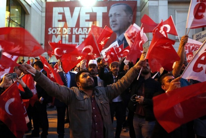 epaselect epa05911419 Supporters of Turkish President Erdogan celebrate as preliminary results of the constitutional referendum are announced in Istanbul, Turkey, 16 April 2017. State-run news agency Anadolu reports a narrow lead for the 'Yes' vote in the unofficial results. The proposed reform, passed by Turkish parliament on 21 January, would change the country's parliamentarian system of governance into a presidential one, which the opposition denounced as giving more power to Turkish President Erdogan.  EPA/DENIZ TOPRAK