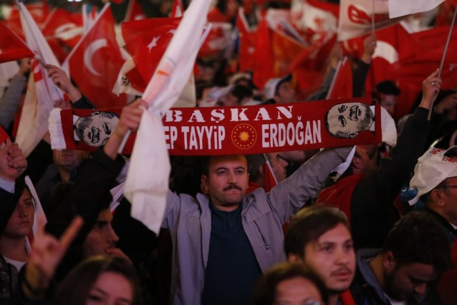 epaselect epa05911716 Supporters of Turkish President Erdogan celebrate as preliminary results of the constitutional referendum are announced in Ankara, Turkey, 16 April 2017. State-run news agency Anadolu reports a narrow lead for the 'Yes' vote in the unofficial results. The proposed reform, passed by Turkish parliament on 21 January, would change the country's parliamentarian system of governance into a presidential one, which the opposition denounced as giving more power to Turkish President Erdogan  EPA/TUMAY BERKIN