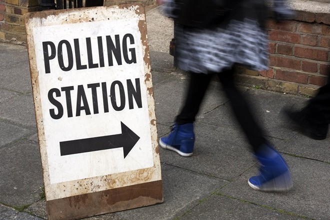 epa05913197 (FILE) - People pass a polling station sign in Brixton, south west London, Britain, 07 May 2015 (reissued 18 April 2017). British Prime Minister Theresa May said in a statement on 18 April 2017 that she was to call for general elections for 08 June 2017.  EPA/HANNAH MCKAY