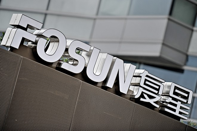 The logo of Fosun Group is seen in front of the company's headquarters building in Shanghai on June 15, 2010. Chinese investment company Fosun bought a seven-percent stake in French leisure group Club Med, which is looking to tap the growing Chinese tourism market whose revenue last year totalled one trillion yuan (146 billion USD, 121 billion Euro). AFP PHOTO/PHILIPPE LOPEZ        (Photo credit should read PHILIPPE LOPEZ/AFP/Getty Images)