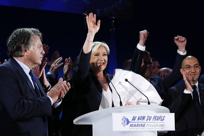 epa05924494 French presidential election candidate for the far-right Front National (FN) party, Marine Le Pen (C) waves to supporters after the results of the first round of the French presidential elections in Henin-Beaumont, Northern France, 23 April 2017. Media reports that polling agencies projections place Le-Pen and centrist presidential candidate Emmanuel Macron in the lead positions for the vote. France will hold the second round of the presidential elections on 07 May 2017.  EPA/IAN LANGSDON