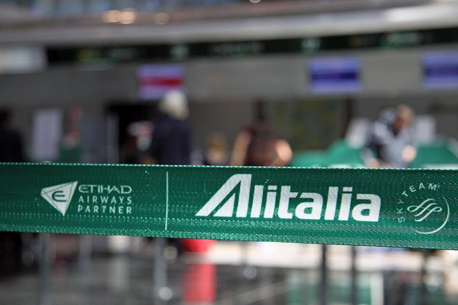 epa05927183 A barrier tape at Alitalia desks at Fiumicino Airport, Rome, 25 April 2017. Etihad-controlled Italian flag carrier Alitalia is now a step closer to liquidation after its employees rejected a rescue plan.  EPA/Telenews