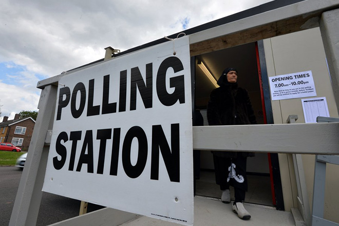 epa05915186 (FILE) - A woman leaves a temporary mobile polling station in Croydon, South London, Britain, 07 May 2015 (reissued on 19 April 2017). British MPs voted at the parliament on 19 April 2017 that they will hold a snap general election on 08 June.  EPA/HANNAH MCKAY