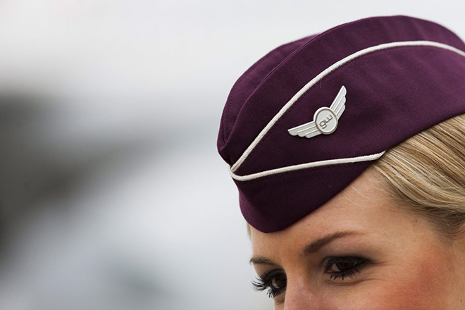 epa03513987 A Germanwings flight attendant wears a hat in the airline's new design at the airport Cologne/Bonn in Cologne, Germany, 19 December 2012.  EPA/ROLF VENNENBERND