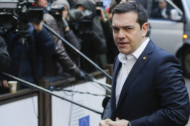 epa05169846 Greek Prime Minister Alexis Tsipras  arrives for the second day of an extraordinary two-day EU summit at EU the headquarters in Brussels, Belgium, 19 February 2016. Negotiations over a reform deal that is meant to keep Britain in the European Union were going into overtime, with EU leaders not expected to be presented with a new proposal until the 19 February afternoon.  EPA/LAURENT DUBRULE