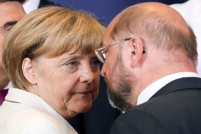 epa05746963 (FILE) - The file picture dated 30 August 2014 shows German Chancellor Angela Merkel (L) and European Parliament President Martin Schulz (R) during a Special Meeting of the European Council at EU Council headquarters in Brussels, Belgium. According to media reports on 24 January 2017, Martin Schulz has been suggested to run as the Social Democrats candidate for German chancellor instead of the Leader of the Social Democratic Party of Germany (SPD) and Vice Chancellor Sigmar Gabriel. Schulz is meant to challenge conservative Chancellor Angela Merkel in the September 2017 election.  EPA/JULIEN WARNAND