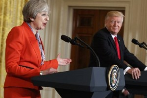 President Donald Trump listens as British Prime Minister Theresa May speaks during a news conference in the East Room of the White House in Washington, Friday, Jan. 27, 2017. (AP Photo/Evan Vucci)