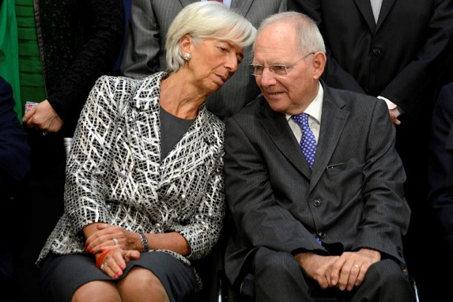 """IMF Managing Director Christine Lagarde (L) chats with German Finance Minister Wolfgang Schauble as they take their seats for a """"family"""" photo for the International Monetary and Financial Committee (IMFC), as part of the IMF and World Bank's 2017 Annual Spring Meetings, in Washington, U.S., April 22, 2017.   REUTERS/Mike Theiler"""