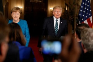 U.S. President Donald Trump and German Chancellor Angela Merkel arrive to speak at a joint news conference at the White House in Washington, U.S., March 17, 2017. REUTERS/Jim Bourg