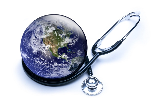 Concept for global medicine with stethoscope reflected in shiny Earth. Isolated on white. Globe public domain courtesy http://visibleearth.nasa.gov/