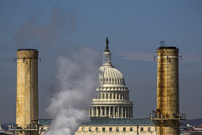 epa06001446 (FILE) - The dome of the US Capitol is seen behind the smokestacks of the Capitol Power Plant, the only coal-burning power plant in the nation's capitol, in Washington, DC, USA, 10 March 2014 (reissued 31 May 2017). US media report on 31 May 2017 that US President Trump is set to withdraw the USA from the Paris Climate Agreement, citing senior officials.  EPA/JIM LO SCALZO