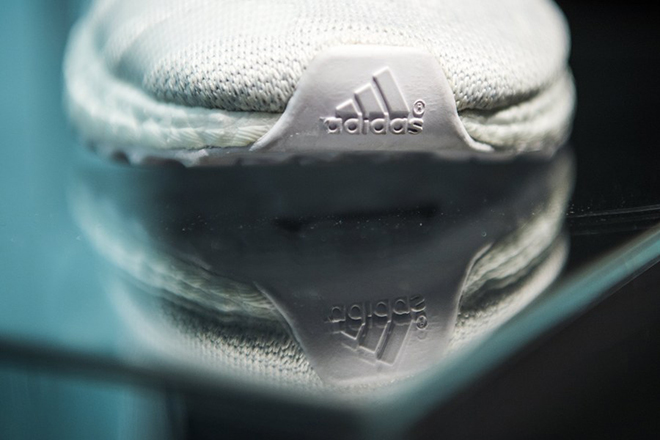 epa05835553 A shoe of German sportswear company Adidas is seen during the company's balance sheet press conference in Herzogenaurach, Germany, 08 March 2017.  EPA/CHRISTIAN BRUNA