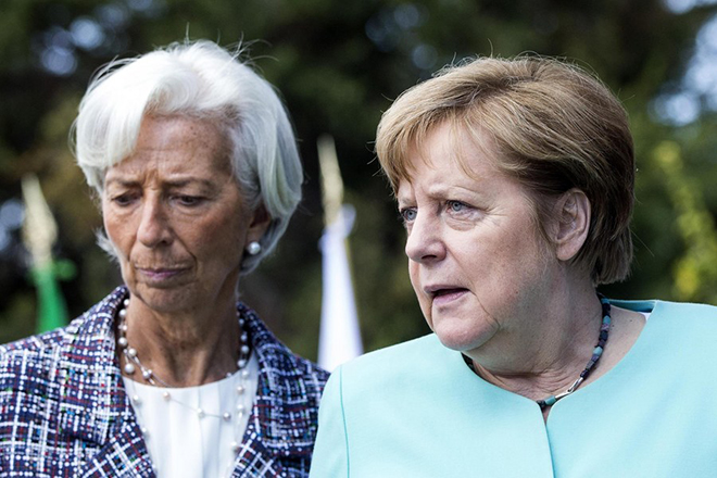 epa05992858 German Chancellor Angela Merkel (R) and Christine Lagarde (L), the Managin Director of the International Monetary Fund (IMF) attend a group photo call  on the second day of the G7 Summit at the San Domenico in Taormina, Sicily, Italy, 27 May 2017. The second day is scheduled to deal with Innovationand Development in Africa, Global Issues such as Human Mobility, Food Security and Gender Equality as well as the G7 Global Relations,  the Italian G7 Presidency said in a media release. Heads of States and of Governments of the G7, the group of most industrialized economies, plus the European Union, meet in Taormina, Italy, from 26 to 27 May 2017 for a summit titled 'Building the Foundations of Renewed Trust'.  EPA/ANGELO CARCONI