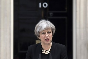 epa06009502 British Prime Minister Theresa May delivers a statement on the previous night's terrorist incident, at Downing Street, in London, Britain, 04 June 2017. At least seven members of the public were killed and dozens injured after three attackers on late 03 June plowed a van into pedestrians and later randomly stabbed people on London Bridge and nearby Borough Market. The three attackers wearing fake suicide vests were shot dead by police who is treating the attack as a 'terrorist incident.'  EPA/WILL OLIVER