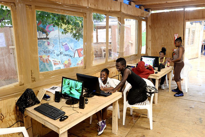 epa03770199 Children use computers in an internet space that is part of the Gramsci Monument, an art installation by the Swiss artist Thomas Hirschhorn on the grounds of the Forest Houses in the Bronx, New York, USA, 01 July 2013. The installation, which pays tribute to the Italian political theorist Antonio Gramsci, was built with the help of area residents and runs through 31 December 2013. The project is the fourth in the Hirshhorn's series of monuments dedicated to major writers and thinkers.  EPA/JUSTIN LANE
