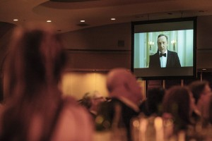 """epa03679646 US actor Kevin Spacey appears on screen in a skit based on the hit show 'House of Cards""""  during the White House Correspondents' Association (WHCA) in Washington, DC, USA, 27 April 2013.  EPA/PETE MAROVICH / POOL"""