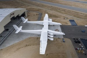 epa06004325 A handout photo made available on 01 June 2017 by Stratolaunch Systems Corp. showing the Stratolaunch aircraft rolling out of its hangar for the first time ever in Mojave, California, USA, 31 May 2017. The plane, which is the world's largest with a wingspan of 385 feet (117m), will now transition into a phase for ground testing, engine runs, taxi tests and ultimately its first flight according to a statement from CEO Jean Floyd.  EPA/STRATOLAUNCH SYSTEMS CORP. / HANDOUT  HANDOUT EDITORIAL USE ONLY/NO SALES