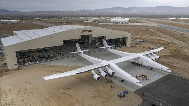 epa06004331 A handout photo made available on 01 June 2017 by Stratolaunch Systems Corp. showing the Stratolaunch aircraft rolling out of its hangar for the first time ever in Mojave, California, USA, 31 May 2017. The plane, which is the world's largest with a wingspan of 385 feet (117m), will now transition into a phase for ground testing, engine runs, taxi tests and ultimately its first flight according to a statement from CEO Jean Floyd.  EPA/STRATOLAUNCH SYSTEMS CORP. / HANDOUT  HANDOUT EDITORIAL USE ONLY/NO SALES