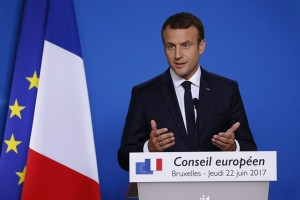 epa06043753 French President Emmanuel Macron speaks at a news conference at the end of the first day of the two days EU Council meeting in Brussels, Belgium, 22 June 2017. European heads of states and governments gather for a two-days European Council meeting on 22 and 23 June which will mainly 'focus on the ongoing efforts to strengthen the European Union and protect its citizens through the work on counterterrorism, security and defence, external borders, illegal migration and economic development', the European Councils said in a press release.  EPA/JULIEN WARNAND