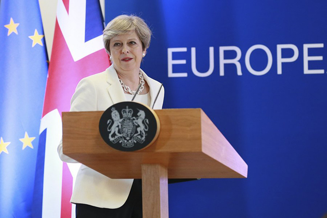 epa06045640 Britain's Prime Minister Theresa May arrives for a press briefing at the end of the European Council in Brussels, Belgium, 23 June 2017. European heads of states and governments gathered for a two-days European Council meeting on 22 and 23 June mainly focussed 'on the ongoing efforts to strengthen the European Union and protect its citizens through the work on counterterrorism, security and defence, external borders, illegal migration and economic development'. On the meeting's second day the EU leaders were expected 'to reaffirm their commitment to a rules-based multilateral trading system, as well as to free trade and investment', the European Council said in a press release.  EPA/OLIVIER HOSLET