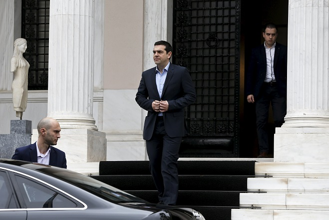 Greek Prime Minister Alexis Tsipras leaves his office in Maximos Mansion after a meeting with his government's financial staff in Athens March 27, 2015. Greece's European Union and IMF lenders, informally called the Brussels Group, will start discussing on Friday a list of reforms being submitted by the Greek government, a government official said.  REUTERS/Alkis Konstantinidis