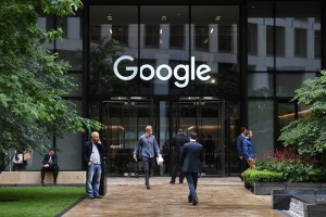 epa06052510 Pedestrian walk past by the Google office in St Pancras in London, Britain, 27 June 2017. The European Commission on 27 June 2017 would fine the Google with 2.4 billion euros for abusing its dominance as a search engine. The company has 90 days to stop its illegal activities or face fines.  EPA/FACUNDO ARRIZABALAGA