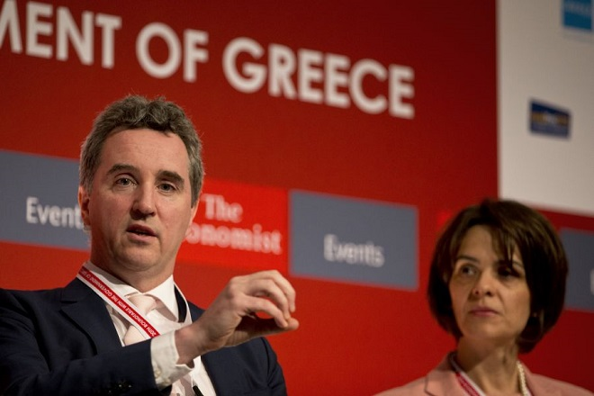 European Commission's mission chief for Greece, Declan Costello speaks next to International Monetary Fund (IMF) mission chief for Greece, Delia Velculescu, right, during an Economy conference, in Lagonisi southeast of Athens, on Wednesday, June 22, 2016. Greece's left-led government wants to ease its budgetary saving commitments after its current multi-billion euro bailout ends in 2018, a senior official says. (AP Photo/Petros Giannakouris)