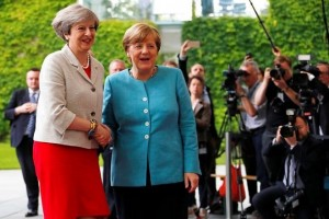 Prime Minister Theresa May is welcomed by German Chancellor Angela Merkel at the Chancellery in Berlin, Germany June 29, 2017. REUTERS/Fabrizio Bensch