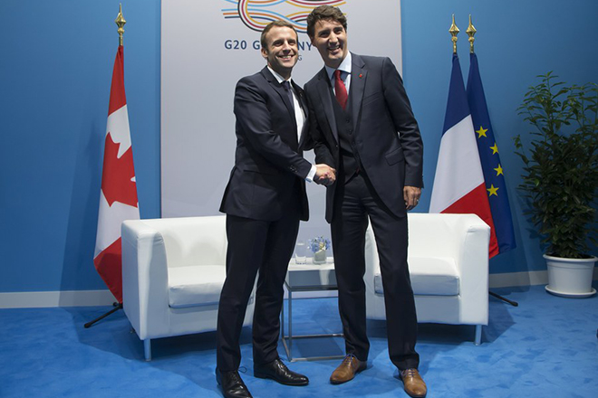 epa06073168 French President Emmanuel Macron shakes hands with Canadian Prime Minister Justin Trudeau (R) during a bilateral meeting on the opening day of the G20 summit in Hamburg, Germany, 07 July 2017. The G20 Summit (or G-20 or Group of Twenty) is an international forum for governments from 20 major economies. The summit is taking place in Hamburg 07 to 08 July 2017.  EPA/IAN LANGSDON