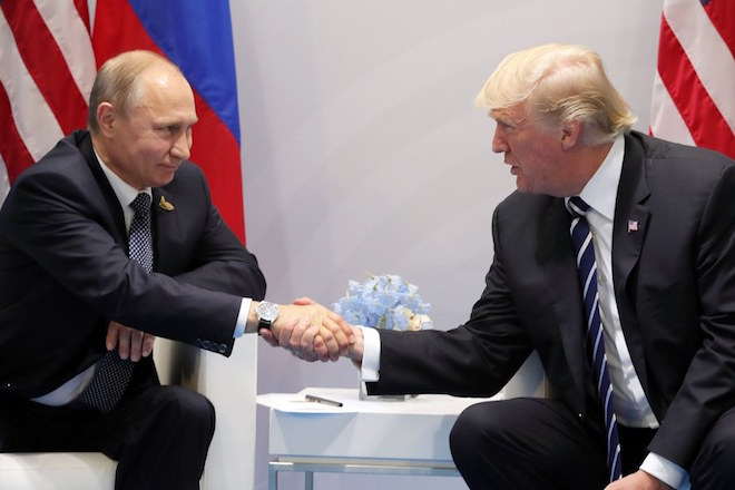 epaselect epa06073306 Russian President Vladimir Putin (L) and US President Donald J. Trump (R) shake hands during a meeting on the sidelines of the G20 summit in Hamburg, Germany, 07 July 2017. The G20 Summit (or G-20 or Group of Twenty) is an international forum for governments from 20 major economies. The summit is taking place in Hamburg from 07 to 08 July 2017.  EPA/MICHAEL KLIMENTYEV / SPUTNIK / KREMLIN POOL / POOL MANDATORY CREDIT