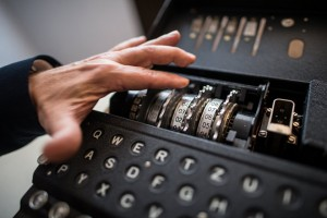 epa05952392 An employee shows an Enigma M4 cipher machine from 1942 during a press preview at the Deutsches Museum in Munich, Germany, 09 May 2017. The Deutsches Museum received a cryptography collection from a German donator. The 30 exhibits will be part of an exhibition in late 2019.  EPA/CHRISTIAN BRUNA