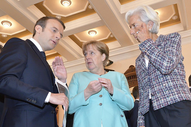 epa05992567 (L-R) French President Emmanuel Macron, German Chancellor Angela Merkel and  International Monetary Fund (IMD) Managing Director Christine Lagarde, chat during the G7 Summit expanded session in Taormina, Italy, 27 May 2017. The second day is scheduled to deal with Innovationand Development in Africa, Global Issues such as Human Mobility, Food Security and Gender Equality as well as the G7 Global Relations,  the Italian G7 Presidency said in a media release. Heads of States and of Governments of the G7, the group of most industrialized economies, plus the European Union, meet in Taormina, Italy, from 26 to 27 May 2017 for a summit titled 'Building the Foundations of Renewed Trust'.  EPA/FLAVIO LO SCALZO