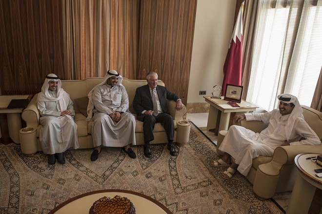 epa06085332 A handout photo made available by the US Department of State shows US Secretary of State Rex Tillerson (3-L) meeting with the Emir of Qatar Sheikh Tamim Bin Hamad Al Thani (R) at the Sea Palace in Doha, Qatar, 13 July 2017. Others are not identified.  EPA/RIEDEL / US EMBASSY OF QATAR / US DEPARTMENT OF STATE HANDOUT  HANDOUT EDITORIAL USE ONLY/NO SALES