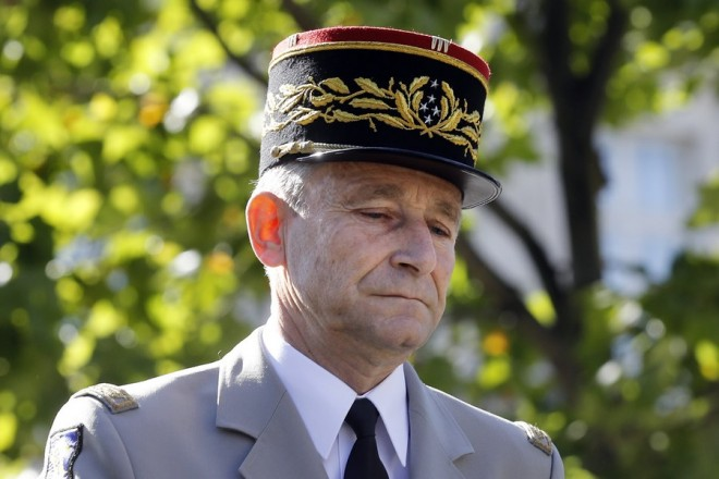 epa06095820 (FILE) - Chief of the Defense Staff, French Army General Pierre de Villiers arrives next to French President Emmanuel Macron (unseen) for the annual Bastille Day military parade on the Champs Elysees avenue in Paris, France, 14 July 2017 (reissued 19 July 2017).  Defense Staff French Army General Pierre de Villiers gave in his resignation to French President Emmanuel Macron on 19 July 2017.  EPA/ETIENNE LAURENT/POOL MAXPPP OUT