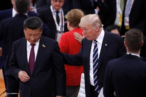 epa06072951 US President Donald J. Trump (R) talks to China's President Xi Jinping (L) during the opening session of the G20 summit in Hamburg, Germany, 07 July 2017. Others are not identified. The G20 Summit (or G-20 or Group of Twenty) is an international forum for governments from 20 major economies. The summit is taking place in Hamburg 07 to 08 July 2017.  EPA/PHILIPPE WOJAZER / POOL MAXPPP OUT