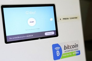 epa06057131 A bitcoin auto teller machine (ATM) located in Launceston, Tasmania, 29 June 2017 (issued 30 June 2017). Bitcoin is a cryptocurrency, that works on a technology system where transactions are recorded in a public ledger called a blockchain. At least 100,000 businesses reportedly accept bitcoin as many more join to provide services to those who are using a cryptocurrency wallet.  EPA/BARBARA WALTON
