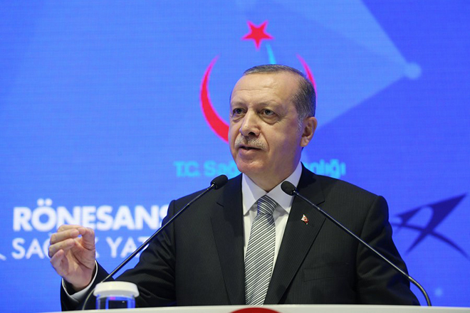 epa06101518 A handout photo made available by the Presidential Press Office shows Turkish President Recep Tayyip Erdogan speaks during a meeting for City Hospital Signing Ceremony in Istanbul, Turkey, 21 July 2017. Erdogan said he strongly condemned a German minister's remarks about investigation on German companies  in Turkey.  EPA/YASIN BULBUL / HANDOUT  HANDOUT EDITORIAL USE ONLY/NO SALES