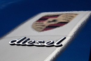 epa06112785 (FILE) - The logo of the car manufacturer Porsche is reflected on the dark paint of a Porsche Cayenne while doing the lettering 'diesel' on the car in Stuttgart, Germany, 04 November 2015. German Transport Minister Alexcander Dobrindt on 27 July 2017 said a forbidden system to shut off cleaning of diesel exhaust emissions has been found to have been installed in 3 Liter diesel engines of Porsche Cayenne SUV models. Dobrindt said a total of 22,000 vehicles Europe-wide will have to be called in to fix the problem.  EPA/CHRISTOPH SCHMIDT GERMANY OUT