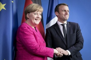BERLIN, GERMANY - MAY 15: German Chancellor Angela Merkel and newly-elected French President Emmanuel Macron attend a press conference at the Chancellery on May 15, 2017 in Berlin, Germany. Macron is visiting Berlin only a day after being sworn in as president in Paris. While Macron and Merkel have both demonstrated an unwavering commitment to the European Union and Merkel strongly applauded Macron's election, they are likely to differ over Macron's desire for E.U.-issued bonds, a measure Merkel has strongly opposed in the past. (Photo by Axel Schmidt/Getty Images)