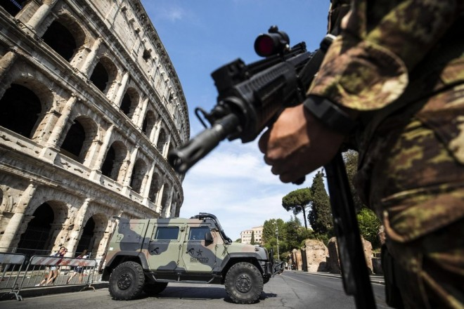 epa06149537 An Italian soldiers patrols in the Colosseum area, the day after the Barcelona terror attack, in downtown Rome, Italy, 18 August 2017. According to media reports, at least 13 people have died and 100 were injured when a van crashed into pedestrians in Las Ramblas, downtown Barcelona in an incident which Spanish police are treating as a terror attack. Similar attack was conducted in coastal city of Cambrils, where five alleged terrorists, who apparently wore bomb belts, were shot dead by security forces on early morning 18 August after they attacked pedestrians using a vehicle next to a promenade, injuring seven people, including a police officer. Police have stated that the attack in Barcelona and the attack in Cambrils are linked. The Islamic State (IS) has claimed the responsibility for the attack in Barcelona.  EPA/ANGELO CARCONI